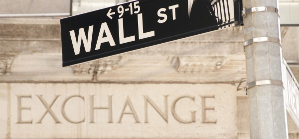 Wall Street sign in front of New York Stock Exchange