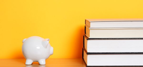 """A piggy bank and a stack of books, can be used for """"saving for college"""" design"""