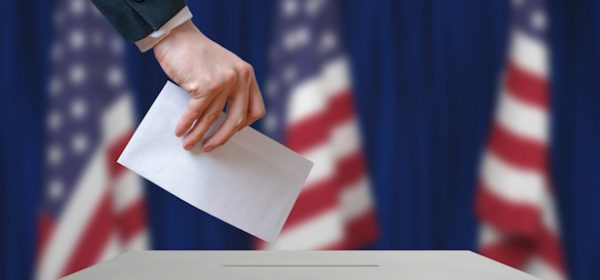 Election in United States of America. Voter holds envelope.