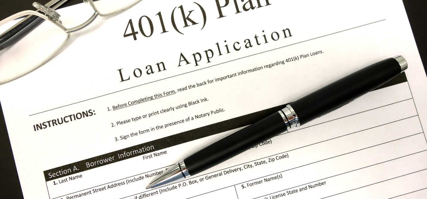 A Generic 401(k) Loan Application on a clean (Black)background, with a pair of reading glasses and a Black pen.