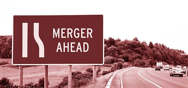 a sepia shot of a road sign saying merger ahead